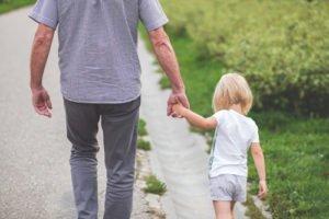 Grandfather walking with Grandkid